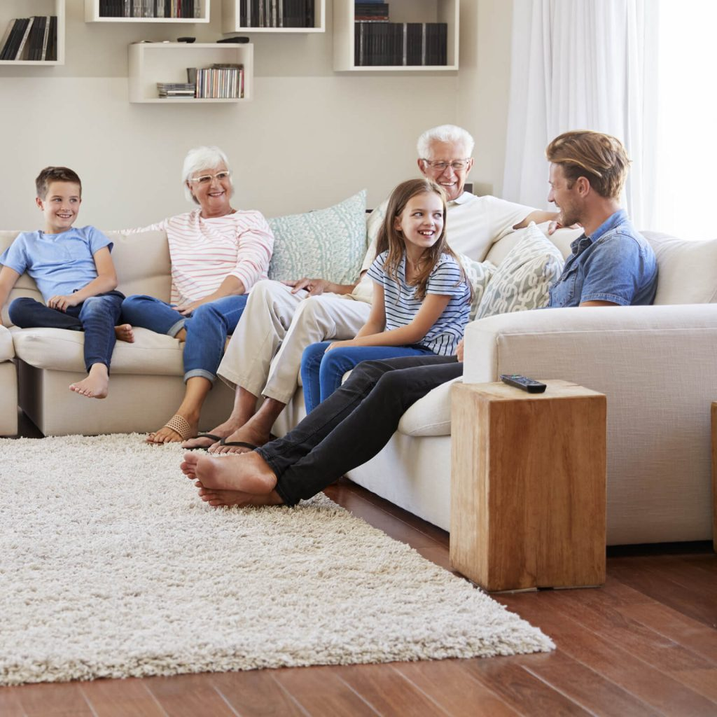 Family gosping in living room | Choice Floor Center, Inc.